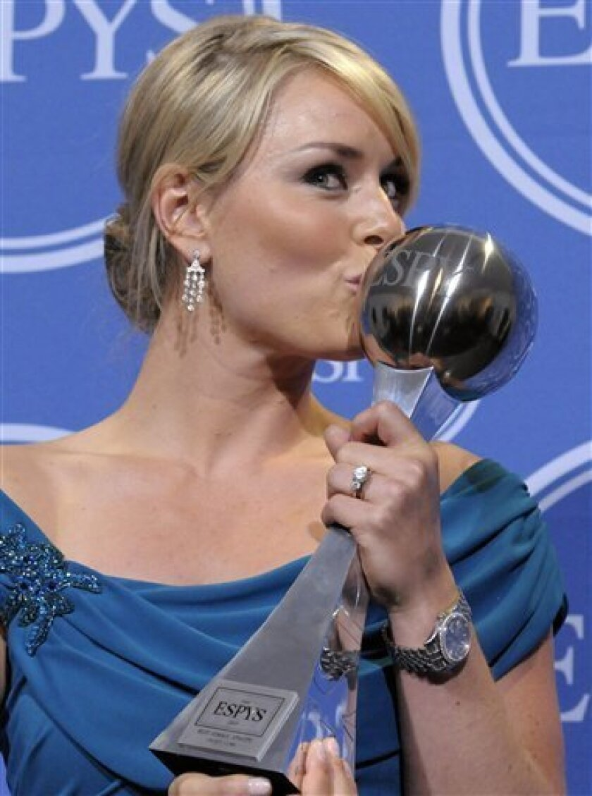 FILE - This July 14 2010, file photo shows skier Lindsey Vonn kissing the award for Best Female Athlete in the press room at the ESPY Awards in Los Angeles. (AP Photo/Dan Steinberg, File)