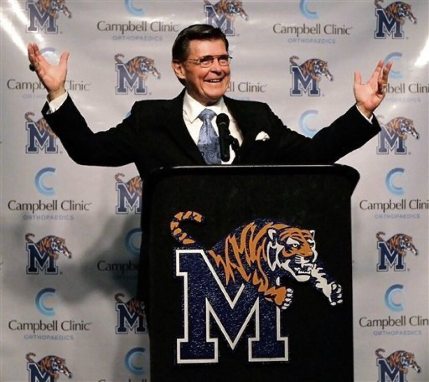 """University of Memphis athletic director R.C. Johnson cheerfully belts out his catch phrase """"It's a great day to be a Tiger,"""" during a news conference to announce that the school officially became the 12th member of the Big East conference, Wednesday Feb. 8, 2012, in Memphis, Tenn.. (AP Photo/The Commercial Appeal, Jim Weber)"""
