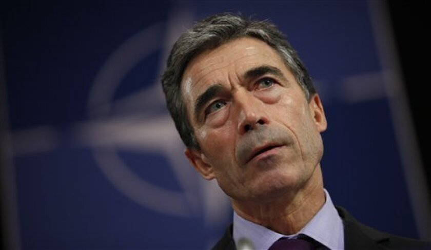 NATO Secretary General Anders Fogh Rasmussen listens to questions during a media conference at NATO headquarters in Brussels on Monday, Oct. 3, 2011. Rasmussen spoke ahead of a two-day defense ministers meeting, which begins on Wednesday, in which ministers will discuss recent developments in Afghanistan and Libya. (AP Photo/Virginia Mayo)