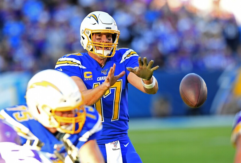 Chargers quarterback Philip Rivers takes a snap against the Vikings.