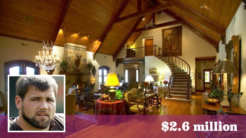 A great room with cathedral-style ceilings and a stone fireplace are among the features of NFL running back Peyton Hillis' ranch property.