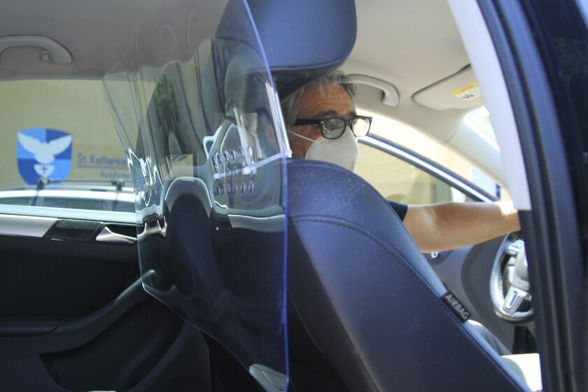 Ricardo Sandoval of Chula Vista shows off the new homemade partition he recently installed in his car.