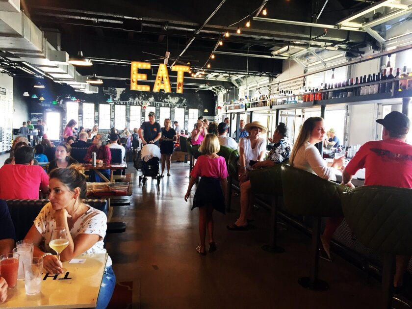 A photo of diners at Windmill Food Hall on Sept. 2. The 12,000-square-foot dining destination, inside the ground floor of the iconic Carlsbad windmill building, opened on Sept. 1.