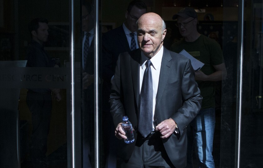 FILE - In this Thursday, Sept. 22, 2016, file photo, Lou Lamoriello leaves an NHL hockey news conference in Toronto. Lamoriello, of the New York Islanders, has won the Jim Gregory general manager of the year award for the second straight year, the NHL announced Tuesday, June 22, 2021. (Chris Young/The Canadian Press via AP, File)