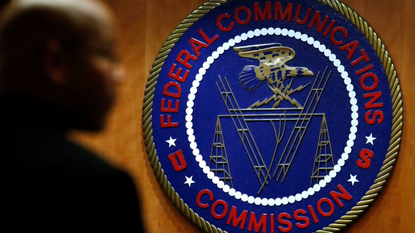 This Thursday, Dec. 14, 2017, photo, shows the seal of the Federal Communications Commission before