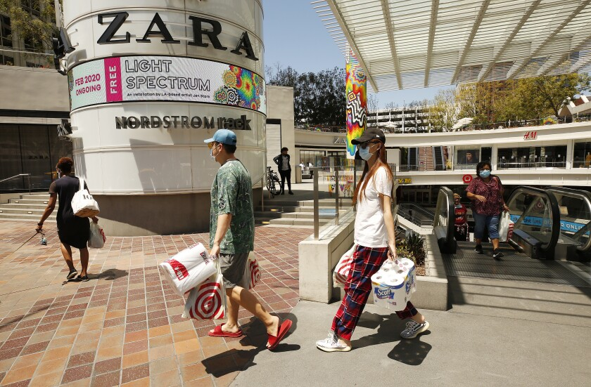 Shoppers were out Tuesday at the FIGat7th open-air mall in downtown L.A., where the food court and several businesses are open.