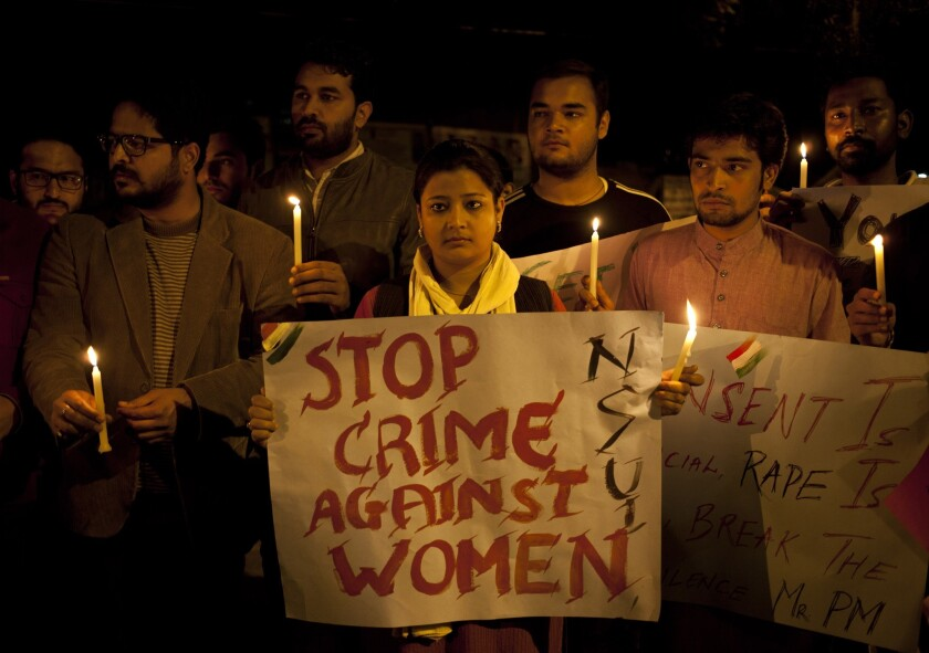 Indian youth hold candles during a demonstration against sexual violence in New Delhi in February. A BBC documentary in which a man convicted in a horrific gang rape blames the victim is stirring debate in India.