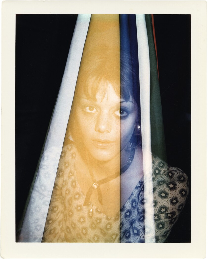 Brigid Berlin's double-exposure Polaroid portrait of Tina Aumont shows the actress filtered by colorful stripes.