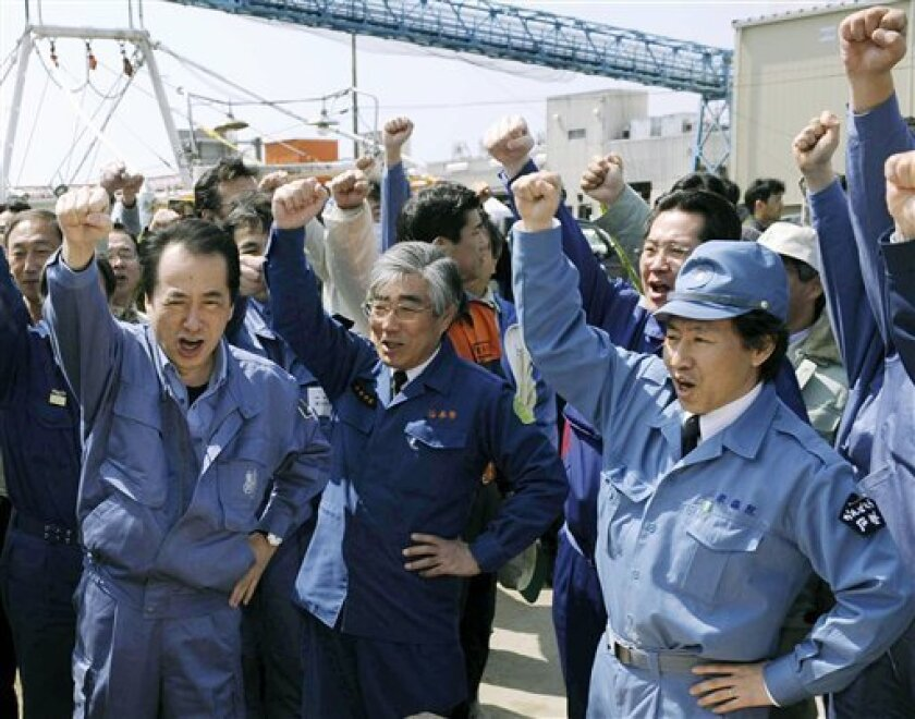"""Japan's Prime Minister Naoto Kan, left, shouts """"Come on, Japan"""" along with Ishinomaki Mayor Hiroshi Kameyama, center, and other people as he visits Ishinomaki, a port town devastated by last month's earthquake and tsunami in northeastern Japan, on Sunday April 10, 2011. (AP Photo/Kyodo News) JAPAN OUT, MANDATORY CREDIT, NO LICENSING IN CHINA, HONG KONG, JAPAN, SOUTH KOREA AND FRANCE"""