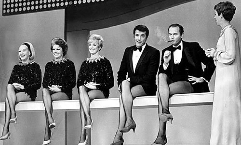 """The late Harvey Korman, second from right, in a 1968 skit on """"The Carol Burnett Show,"""" in which some shapely legs -- and then their owners -- are revealed to the audience. From left, Betty Grable, Martha Raye, Jackie Gregory, Lyle Waggoner, Korman and Burnett."""