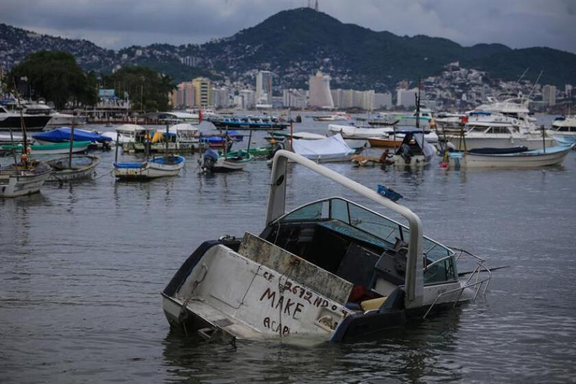 Vista general hoy, domingo 17 de junio de 2018, de las afectaciones propiciadas por el paso de la tormenta Carlotta, en el puerto de Acapulco (México). EFE