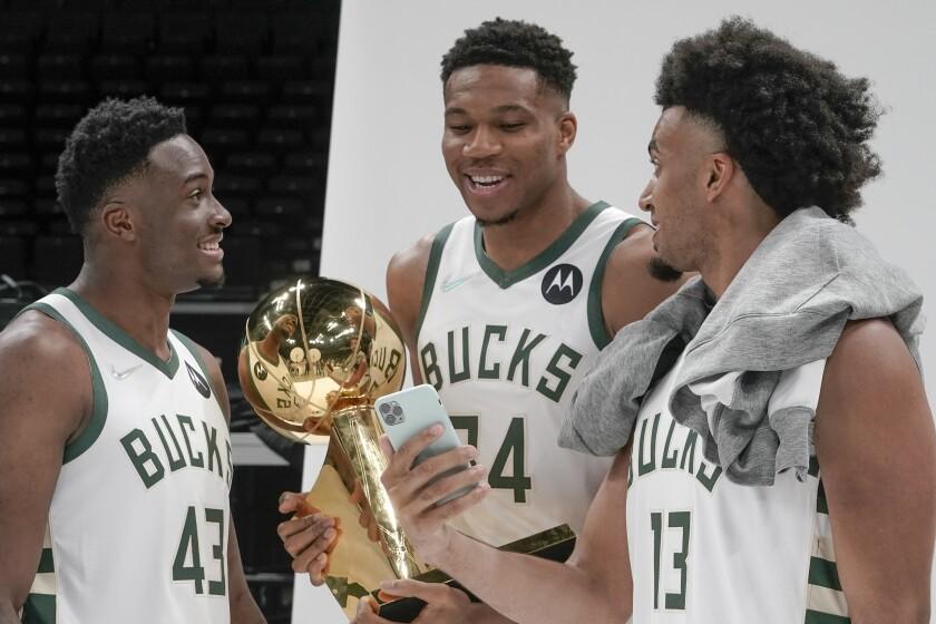 Milwaukee Bucks' Thanasis Antetokounmpo, Giannis Antetokounmpo and Jordan Nwora have some fun during an NBA basketball media day Monday, Sept. 27, 2021, in Milwaukee. (AP Photo/Morry Gash)