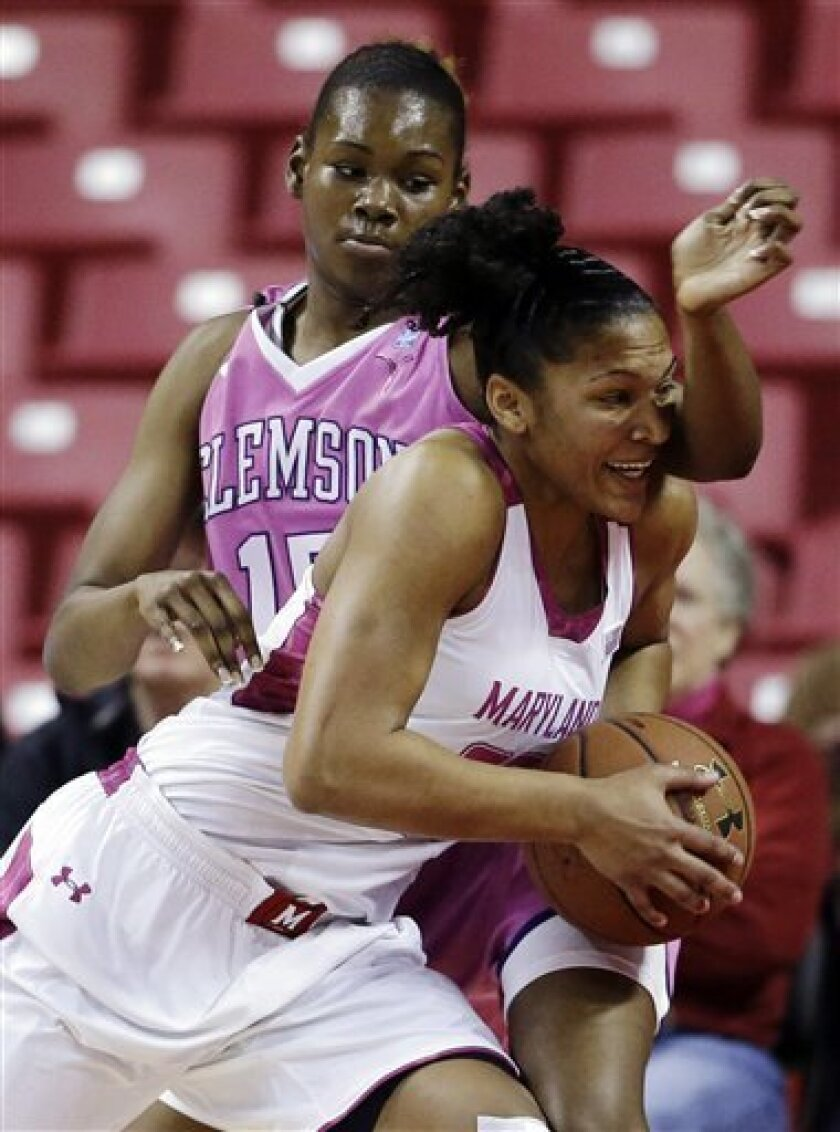 Maryland forward Alyssa Thomas, front, drives against Clemson forward Nyilah Jamison-Myers in the first half of an NCAA college basketball game in College Park, Md., Thursday, Feb. 14, 2013. (AP Photo/Patrick Semansky)