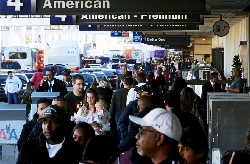 Fliers crowd Los Angeles International Airport during Thanksgiving week in 2015.