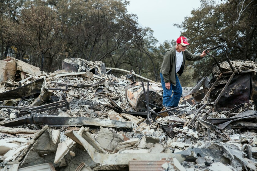 """Jay Albertson searches through the rubble of his home of 30 years after it was burned by the Valley fire in Hidden Valley Lake, Calif. """"This is a chapter in our lives that is gone forever,"""" said Albertson."""