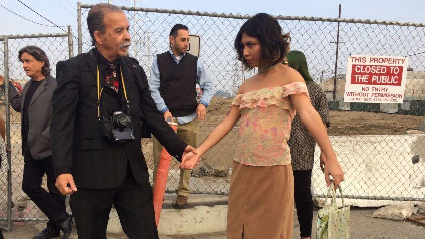 Harry Gamboa, left, poses artist Anais Franco for his latest fotonovela.