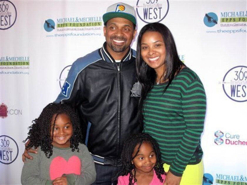 Actor-comedian Mike Epps poses with his family, wife Mechelle, and daughters Mariah, left, and Maddie at an event launching the Michael and Mechelle Epps Foundation, Friday, Feb. 3, 2012 in Epps hometown of Indianapolis. The foundation is aimed at promoting literacy for youngsters. (AP Photo/Nekesa Moody)