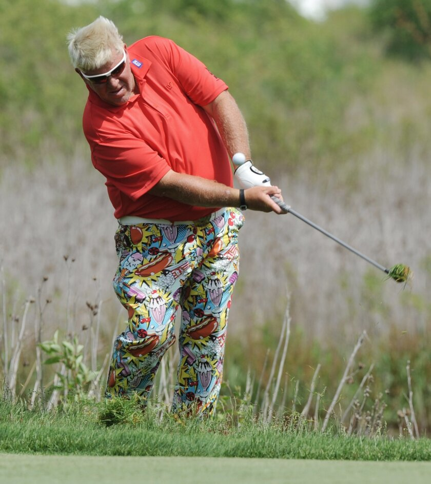 John Daly hits out of the rough on the 16th hole during the first round of the Senior PGA Championship golf tournament at Harbor Shores in Benton Harbor, Mich. (Don CampbellThe Herald-Palladium via AP)