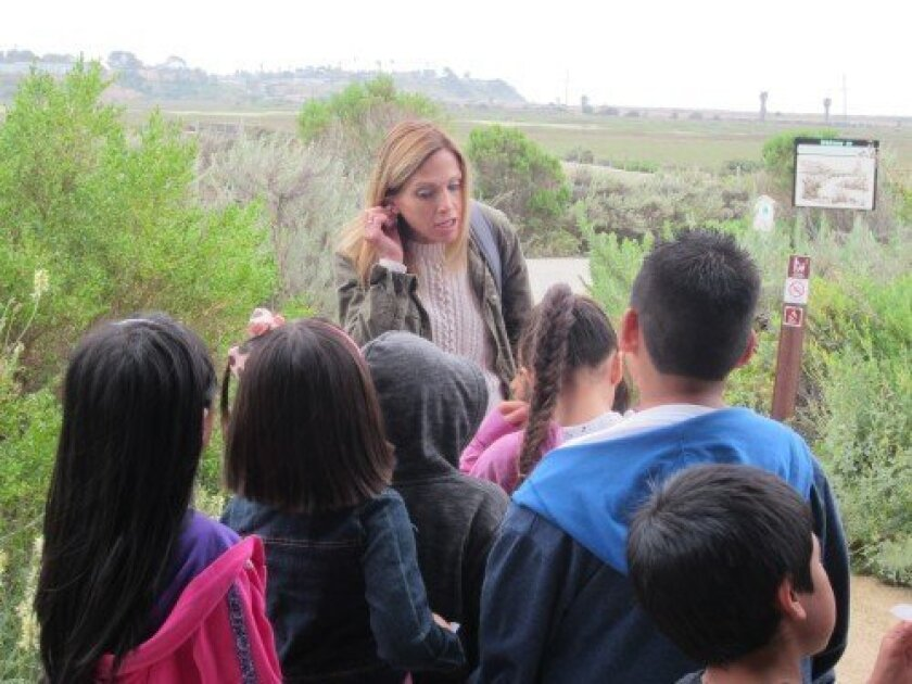 Lagoon docent Erica Peterson, of Rancho Santa Fe, leads a group of first-graders from Foothill-Oak Elementary in Vista. Courtesy photo