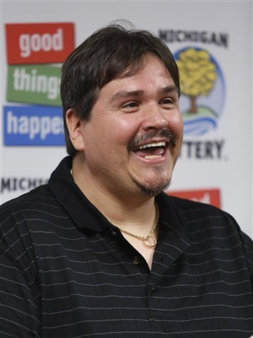 Donald Lawson, a 44-year-old Lapeer, Mich. resident, smiles at a news conference in which he claimed the $337 million Powerball prize Friday, Aug. 31, 2012, at the Michigan Lottery headquarters in Lansing, Mich. Lawson elected the lump sum option of $224.6 million before state and federal taxes. (A