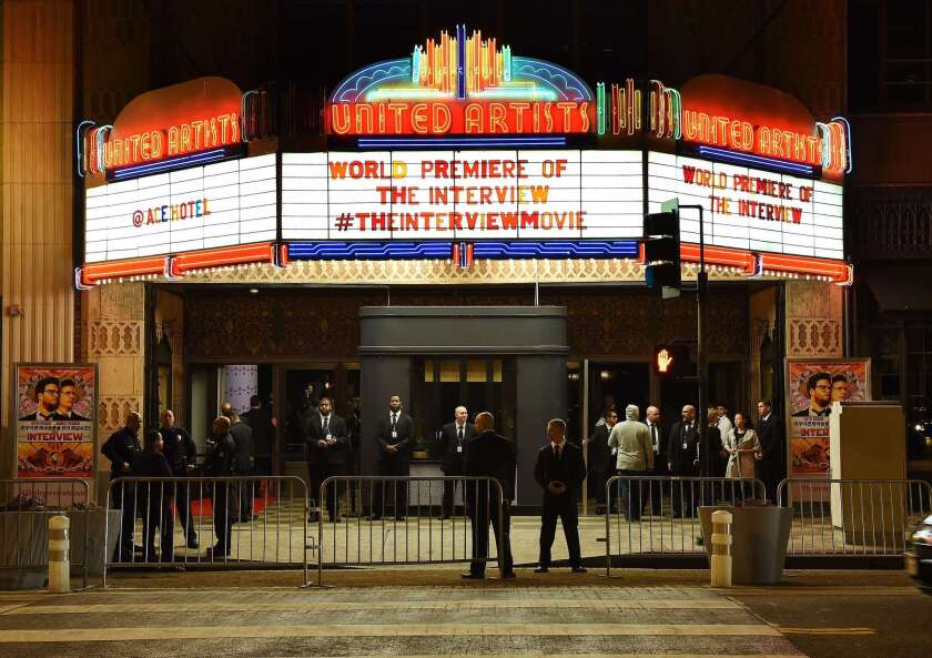 """Security personnel stand outside The Theatre at the Ace Hotel before the premiere of """"The Interview"""" in Los Angeles on Dec. 11."""