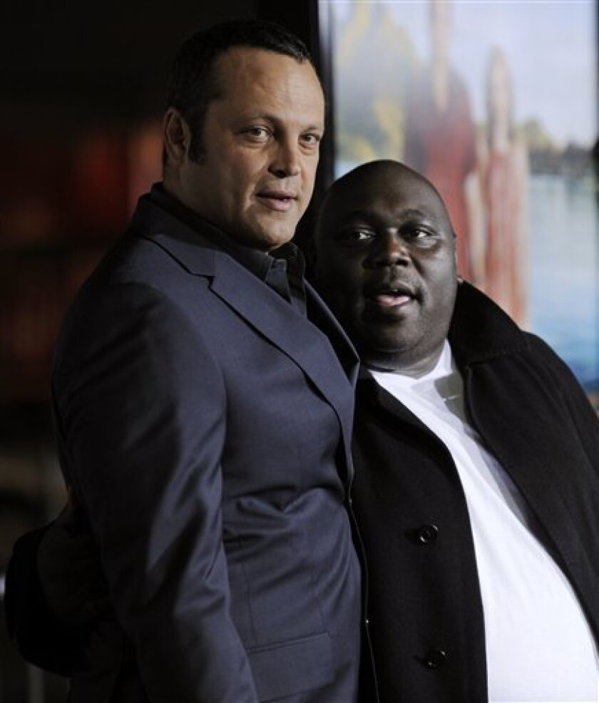 "Vince Vaughn, left, and Faizon Love, cast members in ""Couples Retreat,"" pose together at the premiere of the film in Los Angeles, Monday, Oct. 5, 2009. (AP Photo/Chris Pizzello)"