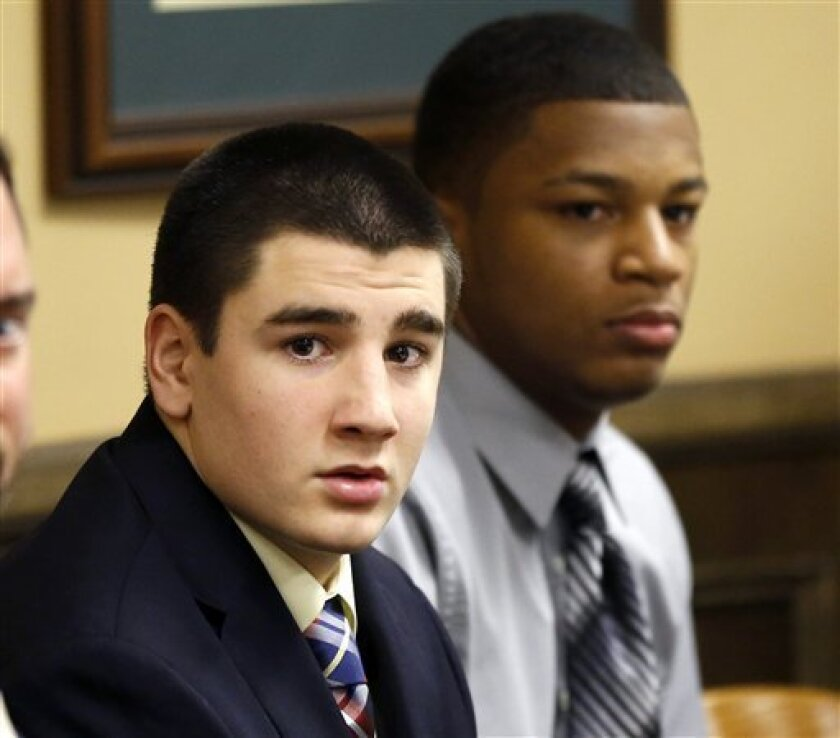 Trent Mays, 17, left, and 16-year-old Ma'lik Richmond sit at the defense table before the start of their trial on rape charges in juvenile court on Wednesday, March 13, 2013 in Steubenville, Ohio. Mays and Richmond are accused of raping a 16-year-old West Virginia girl in August of 2012. (AP Photo/