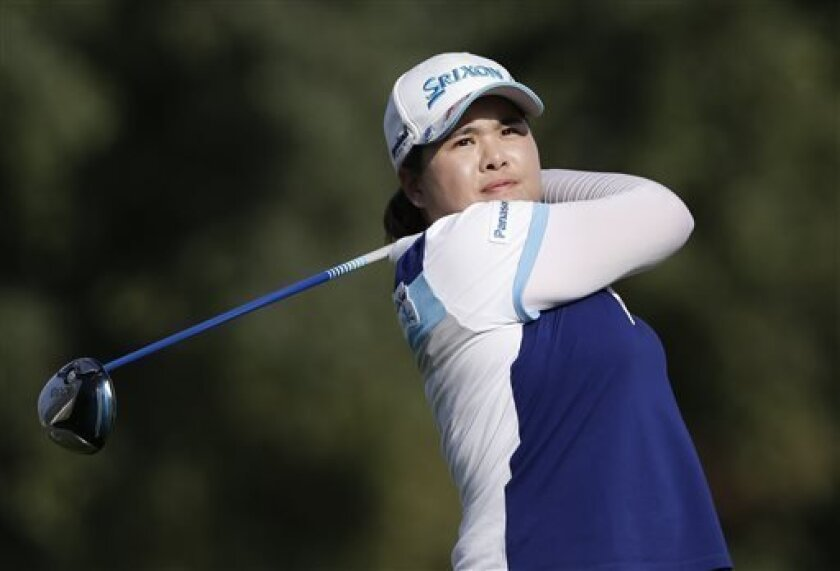 Inbee Park, of South Korea, watches her tee shot on the 16th hole during the final round of the LPGA Kraft Nabisco Championship golf tournament in Rancho Mirage, Calif. Sunday, April 7, 2013. (AP Photo/Chris Carlson)