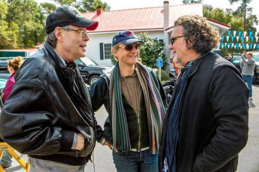 """Executive producer Stephen King, left, director Niels Arden Oplev and executive producer Jack Bender on the set of """"Under the Dome"""" in Wilmington, N.C. The CBS series debuts June 24."""