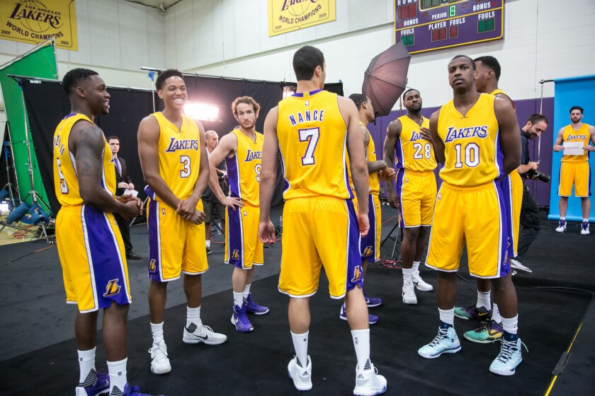 Lakers players wait in line to be photographed at media day in El Segundo on Sept. 28.