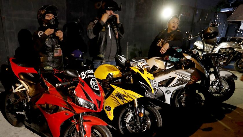 LOS ANGELES, CALIF. - DEC. 7, 2017. Members of the International Brotherhood of Street Racers hang