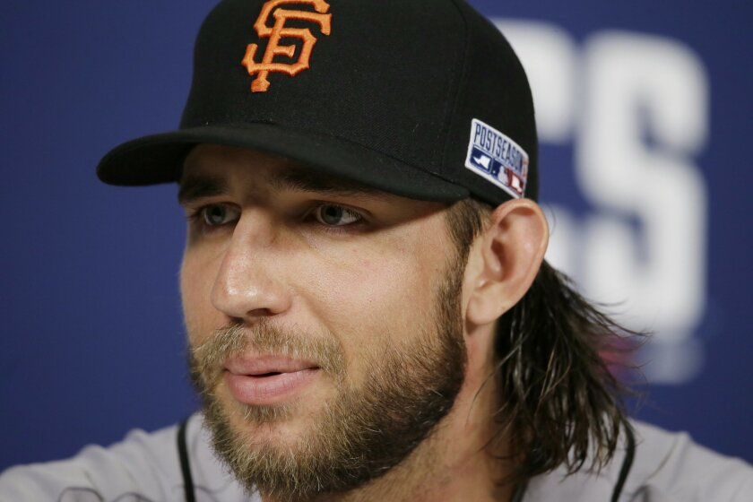 San Francisco Giants starting pitcher Madison Bumgarner speaks to the media, Friday, Oct. 10, 2014, in St. Louis. The St. Louis Cardinals and San Francisco Giants are scheduled to start the National League Championship Series on Saturday in St. Louis. (AP Photo/Charlie Neibergall)