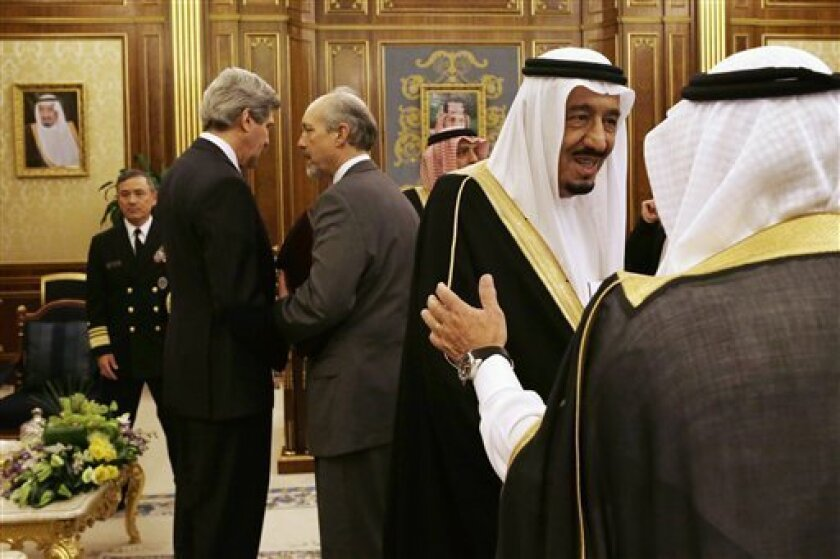 Saudi Crown Prince Salman bin Abdul-Aziz, second right, is greeted as, U.S. Secretary of State John Kerry, second from left, speaks with an advisor before the start of their meeting at Yamamah Palace in Riyadh, Saudi Arabia on Monday, March 4, 2013. Saudi Arabia is the seventh leg of Kerry's first