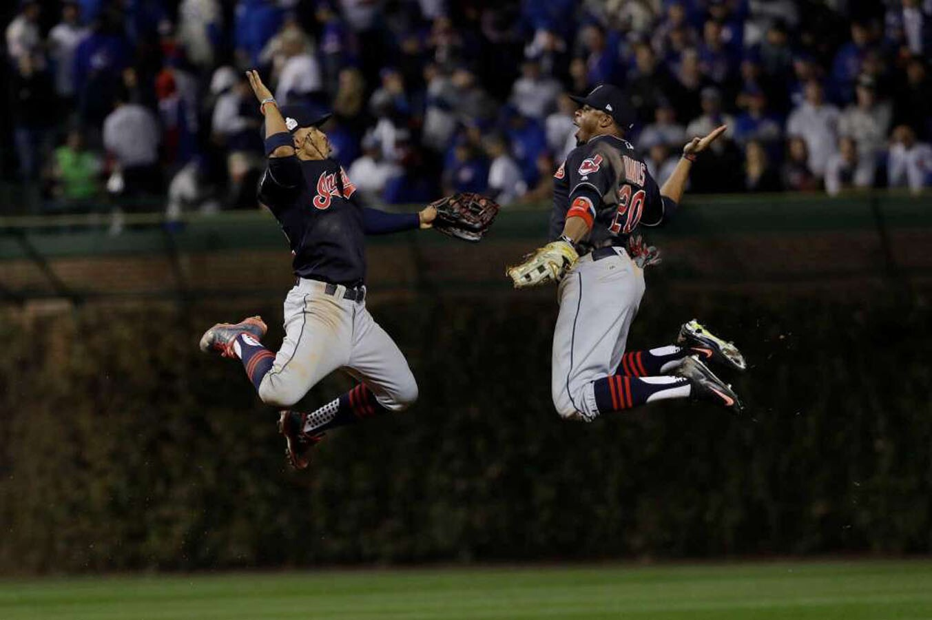 Cleveland Indians' Francisco Lindor and Rajai Davis celebrate after Game 3 of the Major League Baseball World Series against the Chicago Cubs Friday, Oct. 28, 2016, in Chicago. The Indians won 1-0 to take a 2-1 lead in the series.