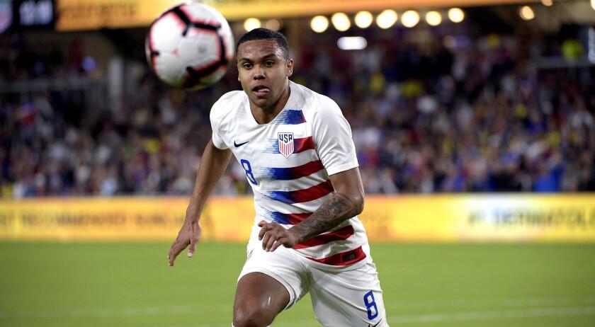 United States midfielder Weston McKennie (8) chases down a ball during the first half of an internat