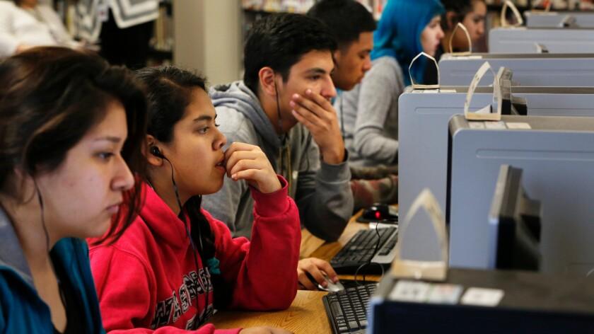 Students staring at screens
