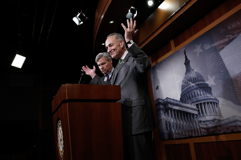 Sen. Charles Schumer (D-NY), right, and Sen. Sheldon Whitehouse (D-RI) speak about the U.S. Supreme Court decision on campaign financing decided Wednesday in McCutcheon vs. F.E.C. during a press conference at the U.S. Capitol.