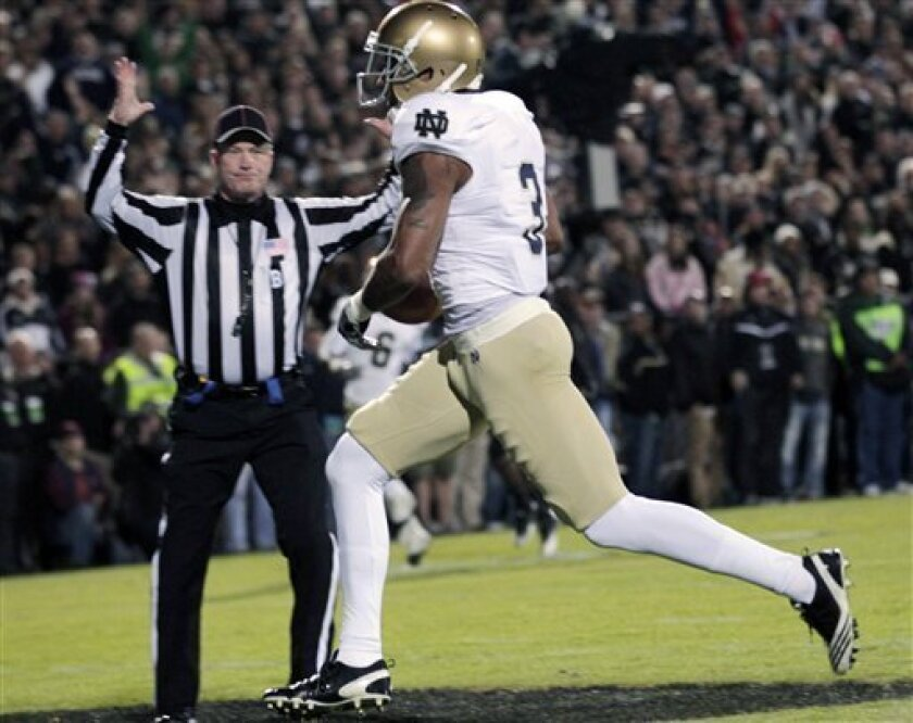 Notre Dame wide receiver Michael Floyd (3) scores a touchdown in the first quarter of an NCAA college football game against Purdue in West Lafayette, Ind., on Saturday, Oct. 1, 2011. (AP Photo/AJ Mast)