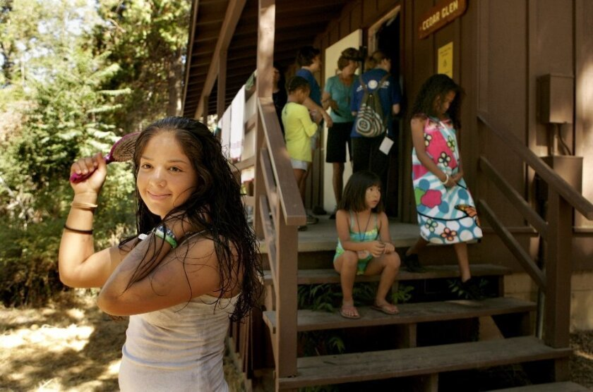Susana, 13, brushed her hair outside a cabin at Camp Cedar Glen-Methodist where Camp Connect took place.