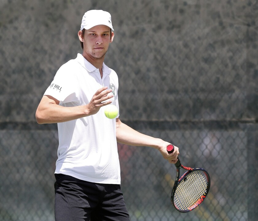 Sage Hill's Emin Torlic focuses on the ball for a forehand return in a singles match competing in on