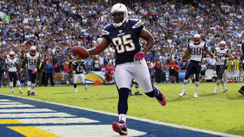 Chargers' Antonio Gates scores a touchdown against the Patriots on Sunday, Oct. 24, 2010.