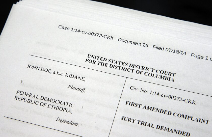 Documents are photographed in Washington, Saturday, July 25, 2015, in a unique lawsuit challenging whether Ethiopia can spy on an American by turning his computer into a giant recording device. in Washington, Saturday, July 25, 2015. The federal case alleges Ethiopian government agents gobbled up months of a Maryland man's Skype calls and his family's Internet activities. But the man, known in court filings as Kidane, born in Ethiopia and now an U.S. citizen, isn't wanted for a crime _ but instead helps out a political opposition group outlawed in his home country. (AP Photo/Manuel Balce Ceneta)