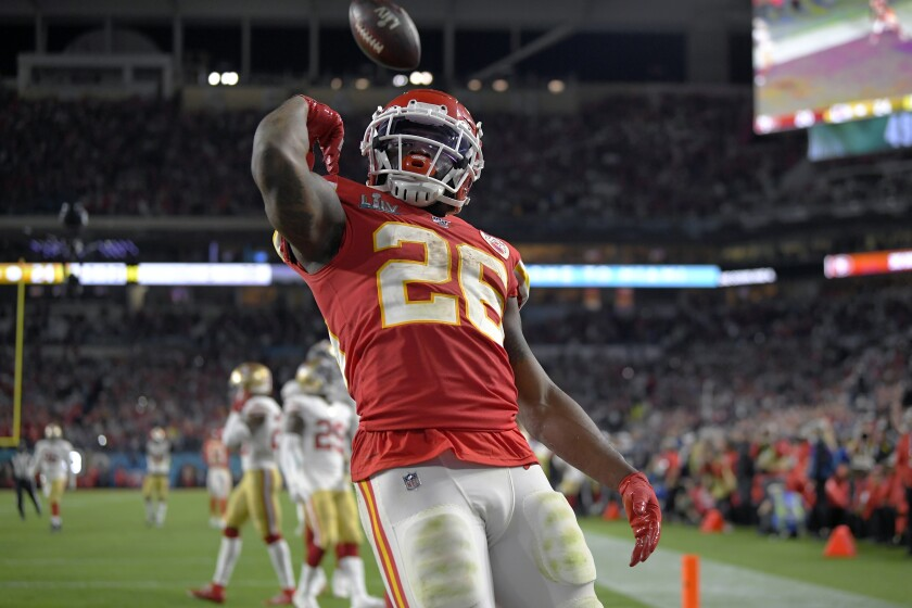 Chiefs' Damien Williams, who attended Mira Mesa High, tosses the ball after scoring a touchdown against the 49ers in Sunday's Super Bowl.