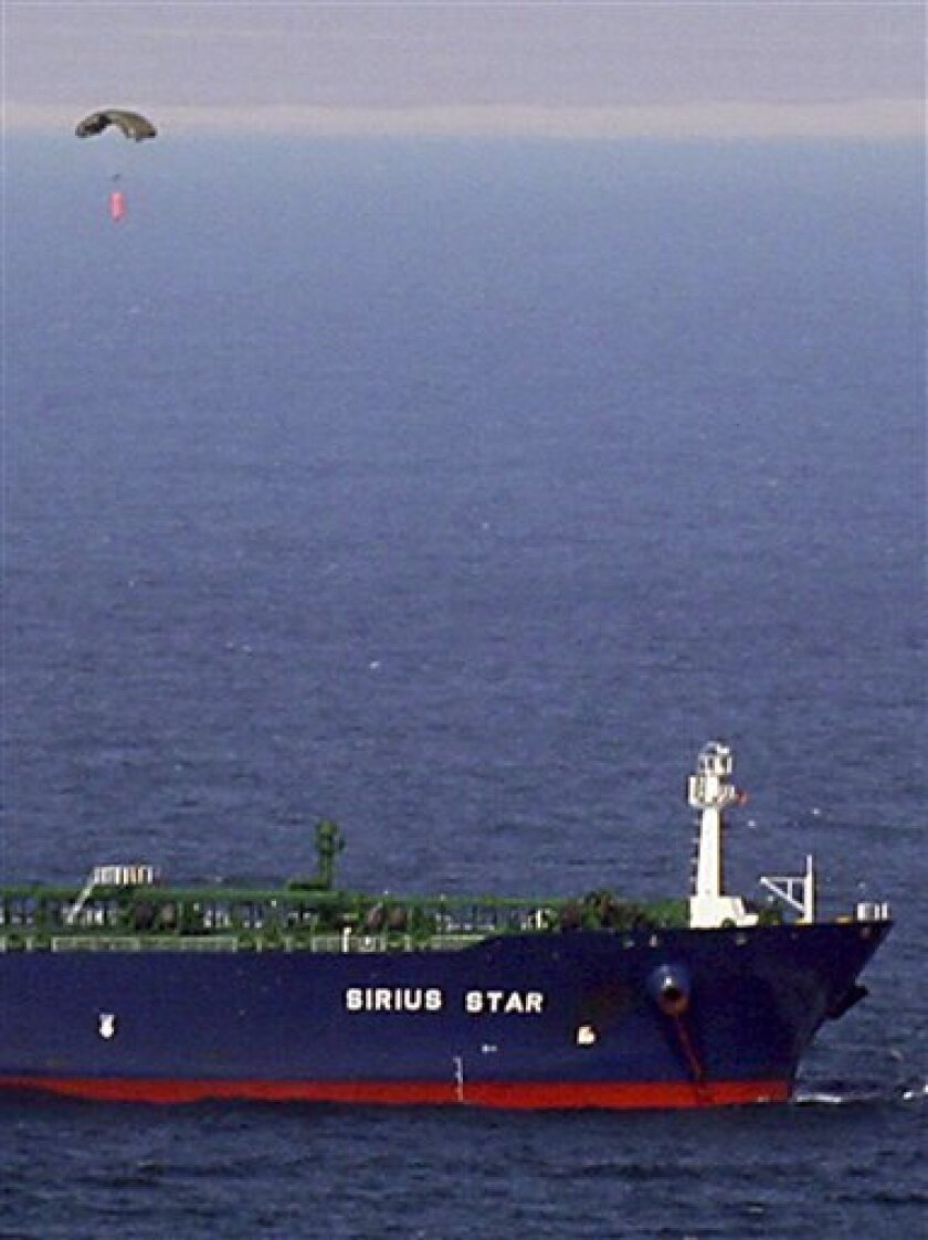 A parachute dropped by a small aircraft drops over the MV  Sirius Star at anchor, in this U.S. Navy photo, Friday, Jan. 9, 2009, following an apparent payment via a parachuted container to pirates holding the ship.  Somali pirates released the oil-laden Saudi supertanker after receiving a $3 millio