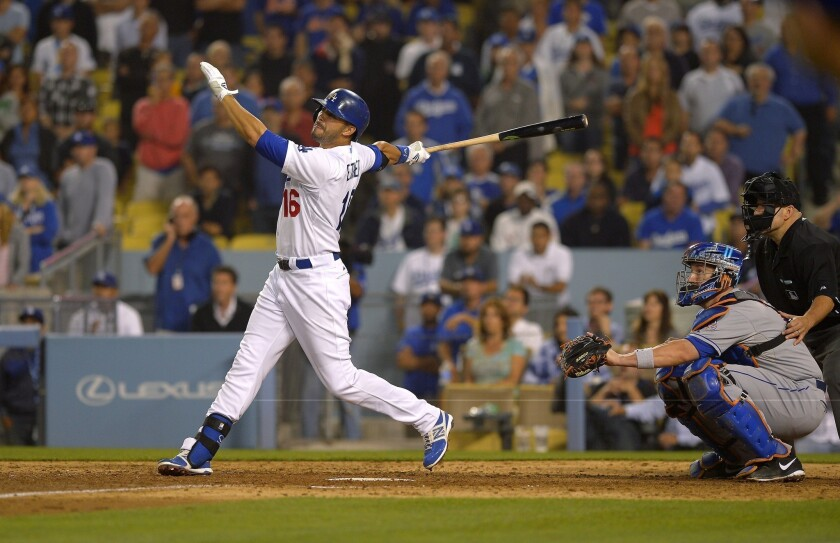 Andre Ethier hits a two-run home run in the bottom of the ninth inning to tie the score during the Dodgers' eventual 12-inning win over the New York Mets on Wednesday night.