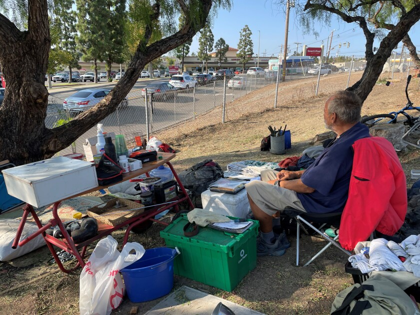 Steven Haynes sits is homeless and sits in a chair near the state Route 78 onramp from Emerald Drive.