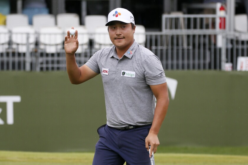 K.H. Lee acknowledges applause from the gallery after sinking a putt on the 17th green.