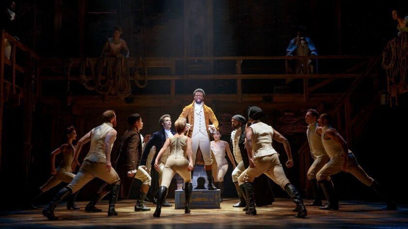"""Michael Luwoye surrounded by the """"Hamilton"""" company, from the national tour's stop in San Francisco."""