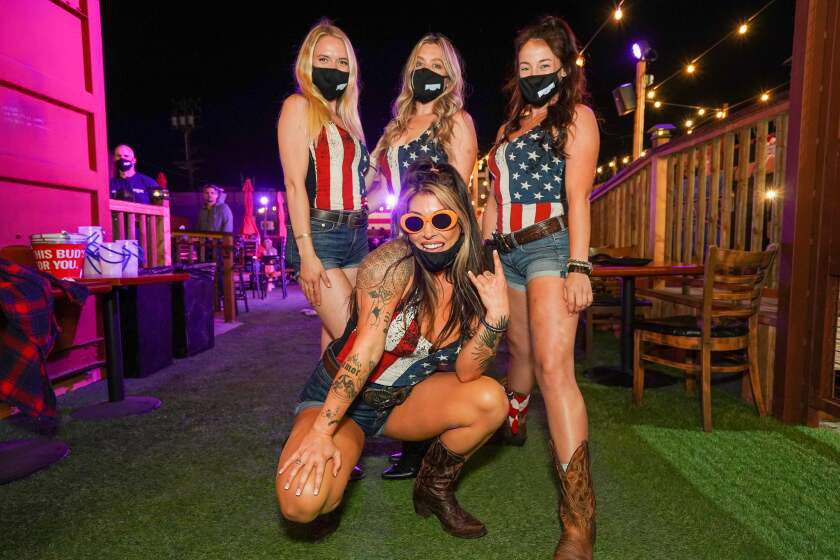 Moonshine Beach employees dressed in patriotic attire in honor of Fourth of July.