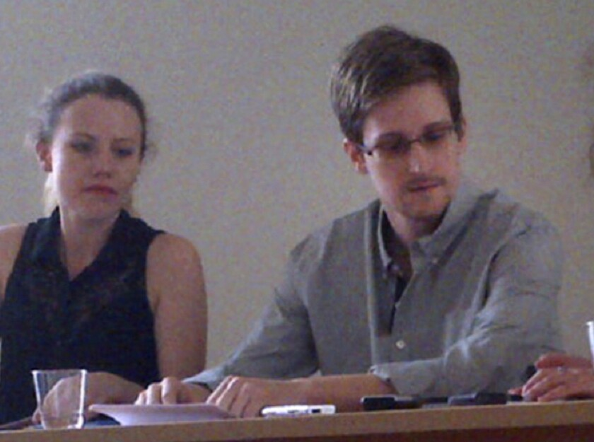 WikiLeaks advisor Sarah Harrison meets with Edward Snowden at Sheremetyevo International Airport in Moscow. The anti-secrecy group hailed its victory in helping Snowden obtain asylum in Russia, but human rights groups warn the American fugitive has landed in a country intolerant of free speech and dissent.
